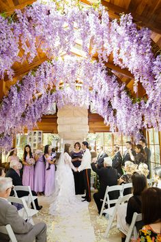 Hanging wisteria decorates this romantic #wedding #reception // Photography by Craven Images.