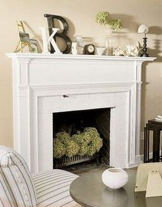 Love the mantle decor plus hydrangeas (or any flower really) in the fireplace for the spring/summer is genius!