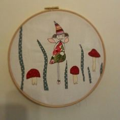 Woodland fairy and toadstool free hand sewing machine hoop.