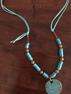 Collar Gamuza Coral turqueza $ 10.000
