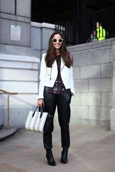 60 Inspiring Street-Style Snaps From LFW #refinery29  http://www.refinery29.com/london-fashion-week/street-style#slide-44  A white biker jacket just adds a touch of polish....