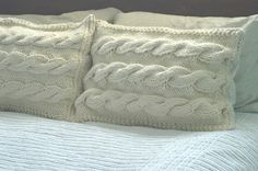 Chunky cable knit pillows.  Goodwill sweaters.  No tutorial needed.  Cut and sew and stuff.