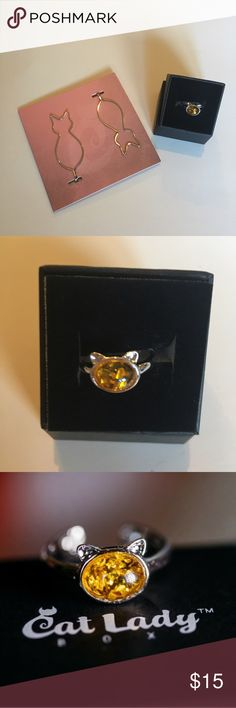 Cat Silver Hair Pins/Cat Amber Silver Ring NIB Cat Lady set of two silver cat bobby-pin style hair clips and silver amber cat ring.  Wrapped in a delicate, cat shaped circle of silver, the hand cut amber stone symbolizes love and tenderness.  Slightly adjustable, open back design.  Pinch the paws closer together to make smaller or pull apart for larger ring size.  Starts at about 7.5 ring size.  Brand new.  Never worn.   Cat Lady Jewelry Rings