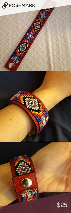 Navajo style leather & bead bracelet This beautifully beaded bracelet includes a stunning pattern of blues, orange, white, yellow and red. Snap closure ensures it will remain securely on the wrist. Ideal for someone with a slightly smaller wrist. Never worn (except for photo).   Makes a lovely holiday gift. Jewelry Bracelets