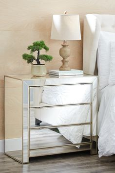 Brighten your bedroom with Pier 1's Alexa Short Mirrored Chest. Built of wood and covered in mirrored glass, our Alexa chest features a flush, squared-off silhouette that's thoroughly on-trend. Three drawers are framed for definition and styled without hardware to maintain the sleek front. Sized to maximize floor space, this piece provides an impressive amount of storage. Because, in addition to those glamorous good looks, Alexa has a practical side, too.