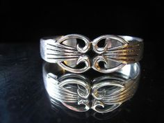 Vintage Native American sterling silver (tested)cuff bracelet with a pierced design and radiating carved lines. In excellent vintage condition, measures 6-inches inside circumference with a 1-inch gap, 3/4-inches wide and weighs 39.3 grams.$125