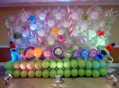 Back wall balloon decor. Candy theme with lights.  www.dreamarkevents.com