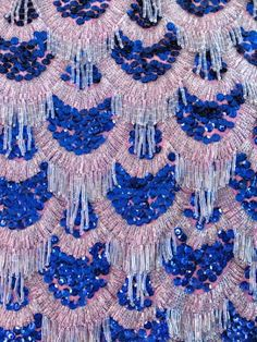 1960s dress covered in blue sequins and clear beads and beaded fringe in a scalloped design