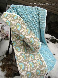 All hand made:One side of the blanket is the daisy fabric, the back is 4 layers of cotton/flannel sewed into rows of diagonal lines and then cut and washed to create faux chenille.