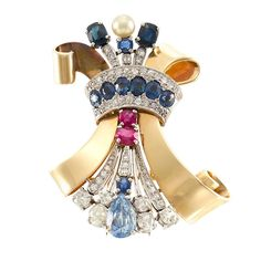 Retro Gold, Platinum, Gem-Set, Diamond and Cultured Pearl Bow Clip  14 kt., one pear-shaped sapphire ap. 3.75 cts., 6 old-mine cut diamonds ap. 1.75 cts., one pearl ap. 5.6 mm., signed V. Parsechian, c. 1940