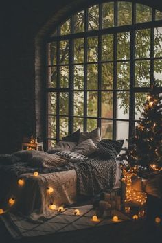 Cute struck bedroom with fairy lights and a little festive tree