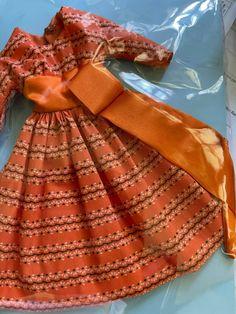 Reproduction Lets Dance vintage Barbie style in orange Fashion Dolls, Fashion Dresses, Barbie Style, Satin Sash, Orange Fabric, Orange And Turquoise, Lets Dance, Vintage Barbie, Pastel Pink
