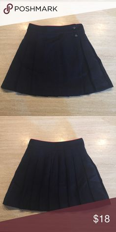 Mini Boden (johnnie B) Wool Pleated Skirt 11-12 Johnnie B Mini Boden Navy Pleated Wool Skirt size 11-12. Fully Lined.  Fabric: 68% Wool 32% poly Smoke free home.  Excellent used condition. No visible signs of wear. Button closure. Thanks for looking.  Bundle and save.  I appreciate the shares. Mini Boden Bottoms Skirts