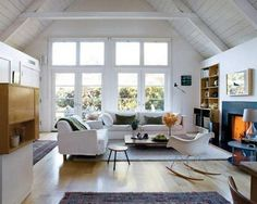 Making rooms in your studio: These studio dwellers chose to embrace the absence of walls and utilize area rugs to dictate separate rooms. They've also arranged furniture as if walls were there anyway - using the back or the couch as a boundary for the living roomspace.