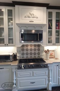 This sweet client of ours recently did a kitchen remodel AND bathroom  renovation. This beautiful kitchen features white cabinets and a custom tile inset over the stove. Visit the blog to see how the bathroom turned out too! | juleptile.com  #kitchen #tileinset #whitekitchen
