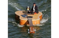Today: Putin's pet tiger, a skyscraper on fire, and a guitar-shaped boat.