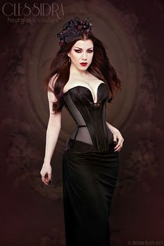 Elegant satin and sheer plunge corset with Swarovski highlights by Clessidra. Photography by Iberian Black Arts. Headgear by Bad Kitty. Modelling by Threnody in Velvet.