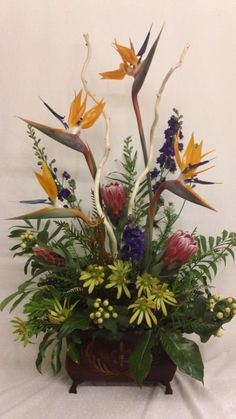 bird of paradise arrangement with stripped curly willow branches
