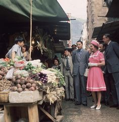 1975 Queen Elizabeth II of Great Britain at a market stall… | Flickr