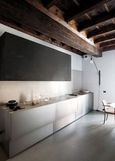 morepicturesthanwords:    Minimal kitchen within a historical interior in Mantua, Italy. Photo by Gianni Basso, via design traveller.