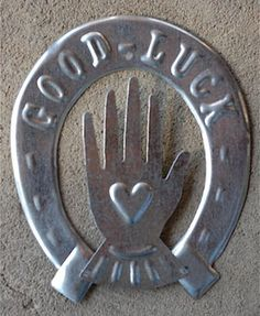 Hand in heart good luck charm...