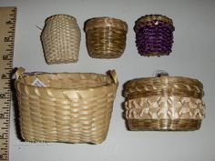 """5 Native American Iroquois Basket Mohawk Split Ash Sweetgrass Akwasasne Mohawk Reservation, NY The 1st basket is split ash by Rita Mitchell. measures 4.25"""" x 3.5"""" x 3""""  2nd basket made by Florence Benedict is split ash w/ sweetgrass & curly cue design. It is 3.5"""" x 2.5""""  3rd basket by Lenora David is a small back pack made from split ash w sweetgrass trim. It measures 2.25"""" x 2"""" x 2"""" x 1 3/8"""" deep.  4th basket by James Jacobs is purple dyed split ash & sweetgrass, w a curly cue design 2 1/8…"""