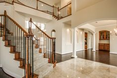 Stunning home built by Grand Homes in Garland, Texas features a split curved staircase, Milano marble entry floor, butler's pantry and more! Curved Staircase, Grand Homes, New Home Builders, Butler Pantry, Building A House, Garland Texas, Home Goods, New Homes, Stairs