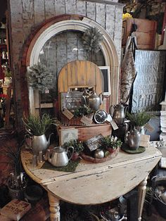 cute pewter display I did at work. Round Barn Potting Company.