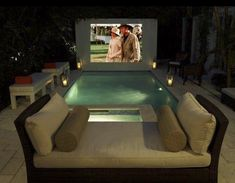 Backyard movie theatre and tropical pool by Campion Platt Interiors