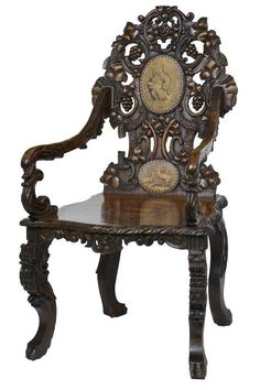 19TH CENTURY CARVED INLAID WALNUT BLACK FOREST ARMCHAIR