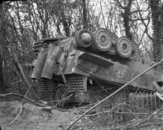 A German Tiger tank (weighing 56 tons) from the 503rd Heavy Tank Battalion blown upside down during the Allied bomber attacks that preceded Operation 'Goodwood'. Despite the devastation caused by the bombing, most of the battalion's Tigers escaped serious damage and by the end of the day had knocked out 40 British tanks.