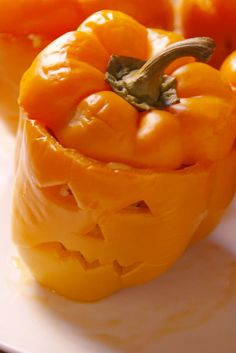 Jack-O'-Lantern Stuffed Peppers  - Delish.com