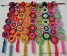 homemade@myplace: A place on the wall !!!! Love this idea. This post shows how the discs were laid out and joined: http://homemadeatmyplace.blogspot.co.uk/2013/05/a-nice-piece-of-fabric.html#links This post shows adding curlicues and pompoms: http://homemadeatmyplace.blogspot.co.uk/2013/05/this-is-it.html