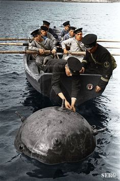 WWII in color, floating mine.