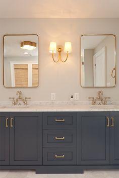 bathroom with navy vanity and gold accents, bathroom sconce, gold metal bathroom mirror, blue cabinets in bathroom design Bathroom Renos, Bathroom Renovations, Bathroom Interior, Bathroom Makeovers, Simple Bathroom, Modern Bathroom, Master Bathroom, Navy Bathroom, Minimalist Bathroom
