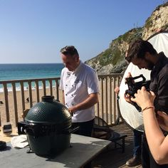 Fish for Thought's Chef Adam working his magic with the Big Green Egg BBQ.  Lusty Glaze Beach, Cornwall