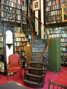 Hanging staircase at the beautiful Library of the Nova Scotia Legislative Assembly in Canada. (Every library needs a red chair)