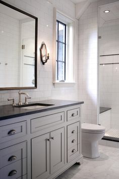Beautiful Bathroom Features Full Height Subway Tile Backsplash Framing A Gray Vanity Sink Topped With Jet Mist Honed Granite Countertop And