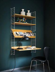 Amazing showroom of Fritz Hansen - magazine display shelf and desk combo