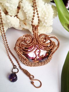 Beautiful fuchsia faceted crystal glass wrapped in by jewelryshore