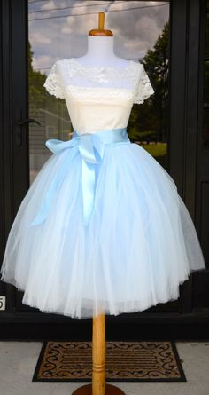 Beautiful tulle skirt made with a soft pale blue tulle in women's sizes including plus sizes. Skirt is made of 6 layers of the highest quality tulle and is fully lined with an elastic waist. Available