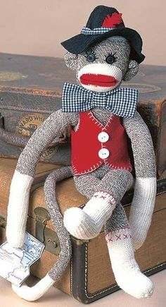Unky the Sock Monkey ePattern - (Leisure Arts Leaflet The luckiest families always have a well-traveled uncle with exciting stories to tell at holiday get-togethers. Sporting a big bow tie, a cocky hat, and a smart vest, our Unky sock monkey is ready Little Monkeys, Sock Monkeys, Sock Monkey Pattern, Monkey Crafts, Cardboard Toys, Sock Toys, Sock Crafts, Pet Monkey, Sock Animals