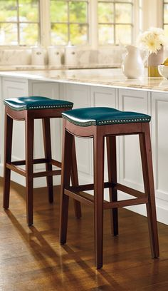 Subtly contoured, the Julien Leather Bar Stool has a comfortable upholstered seat articulated with brushed-nickel nailhead accents and covered with durable leather.