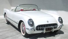 1954 Corvette - For all practical purposes the 1953 and 1954 Corvettes were the same.  Unlike the previous year's model (which offered only Polo White), the 1954s were also available in Pennant Blue, Sportsman Red, and Black.  The soft top was now offered in beige.