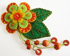 Flower Brooch - Orange Felt Flower with Decorative Embroidery. €13.00, via Etsy.