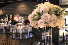 Lovely, full centerpieces of hydrangea, lilies, roses & mums in all white.