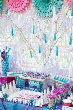 Disney's Frozen - I love the rock candy hanging from the branch, and the shimmery curtain as backdrop.