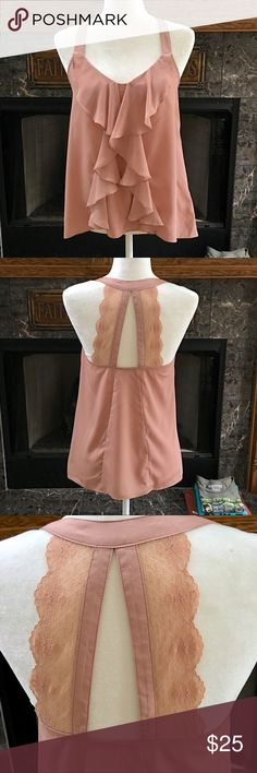 Lauren Conrad Adorable Tank Top 🌸ADORABLE🌸 Lauren Conrad Tank with lace back straps and vertical ruffle down the front size XS. Color is hard to define. It's a muted peach maybe??? If someone can define it, please do! LC Lauren Conrad Tops Tank Tops