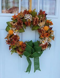 """Large 18"""" muted fall tones wreath created with grapevine base. This bright colored wreath will add beauty to your entrance. Large size perfect for doors and mantels. Harvest, Autumn, Fall Wreath with hydrangea, poppy, peony and mums. Beautiful handmade green burlap bow. Accented with orange puffs and berries"""