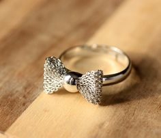 Silver Bow Ring  by Diament Designs    Adjustable, sweet little bow ring.